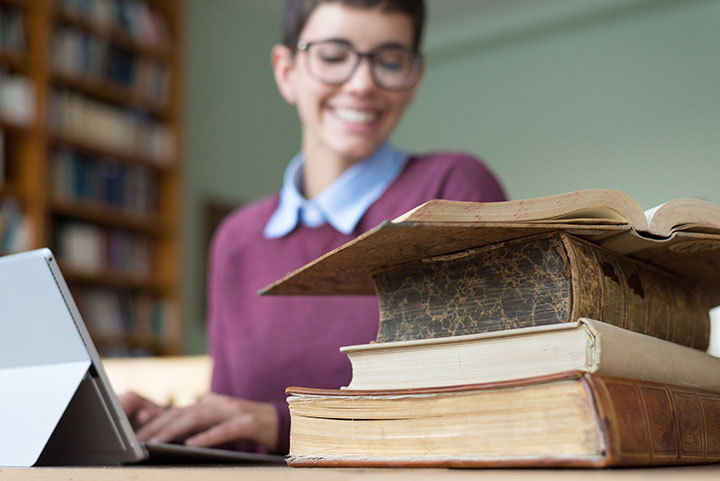 Student making endnotes and bibliography in research paper