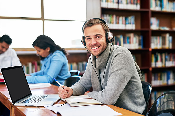 college student headphones citing audio video Chicago Author Date Style