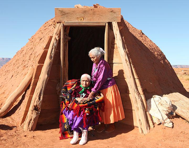 Two Navajo Women Outside Their Hoga